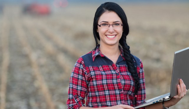 Woman in Field with Laptop